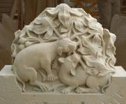 console with two dogs in sandstone