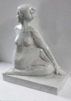 hatha yoga pose Ardha Matsyendrasana in white carrara marble