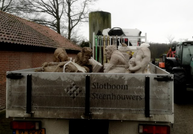 truck loaded with flying buttress figurines