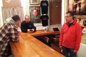 Mark (center) and Guy chat with local beer appreciator