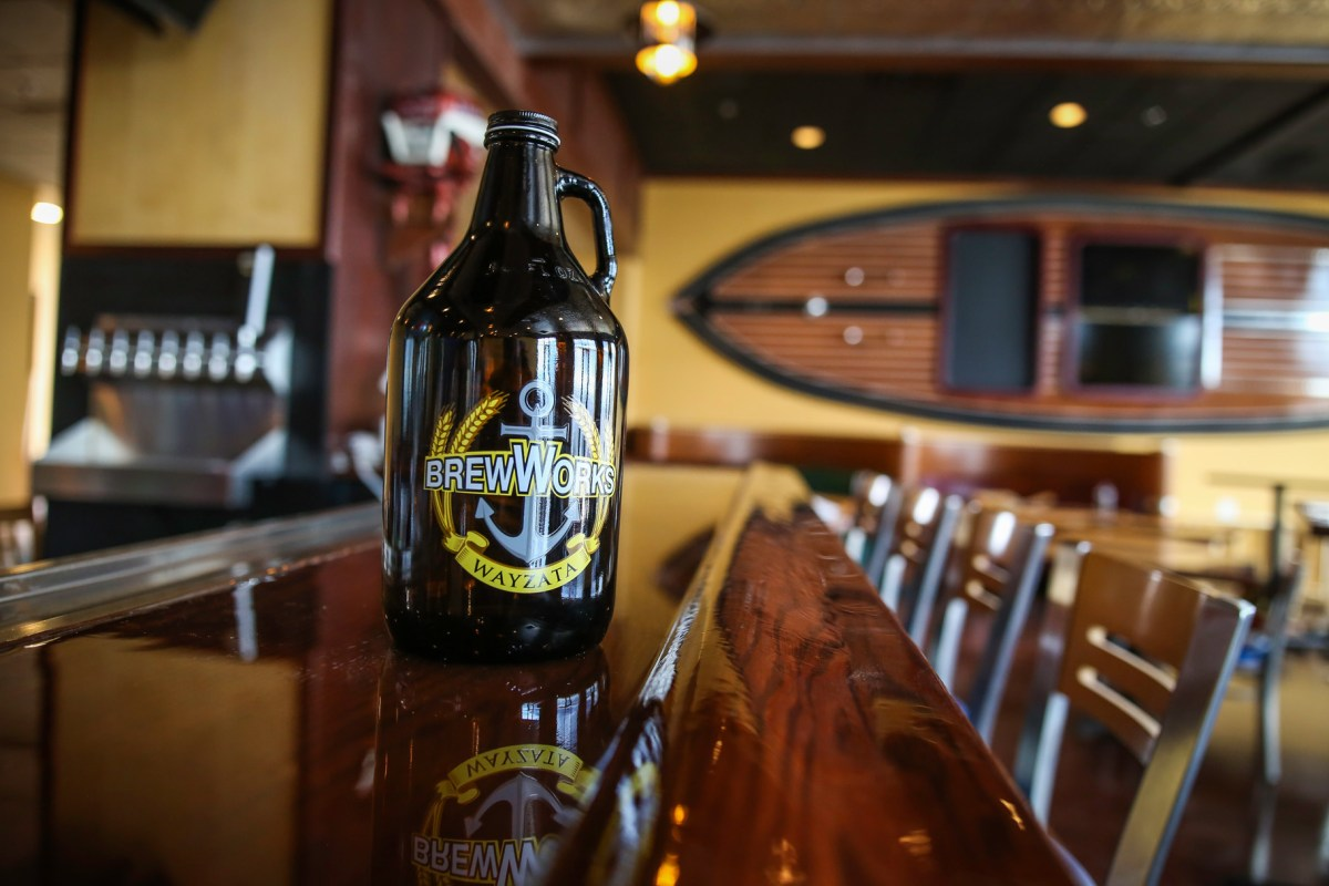 <em>A branded growler sits on the bar at Wayzata Brew Works around the time of the brewery's opening in 2016. • Photo by Aaron Davidson</em>