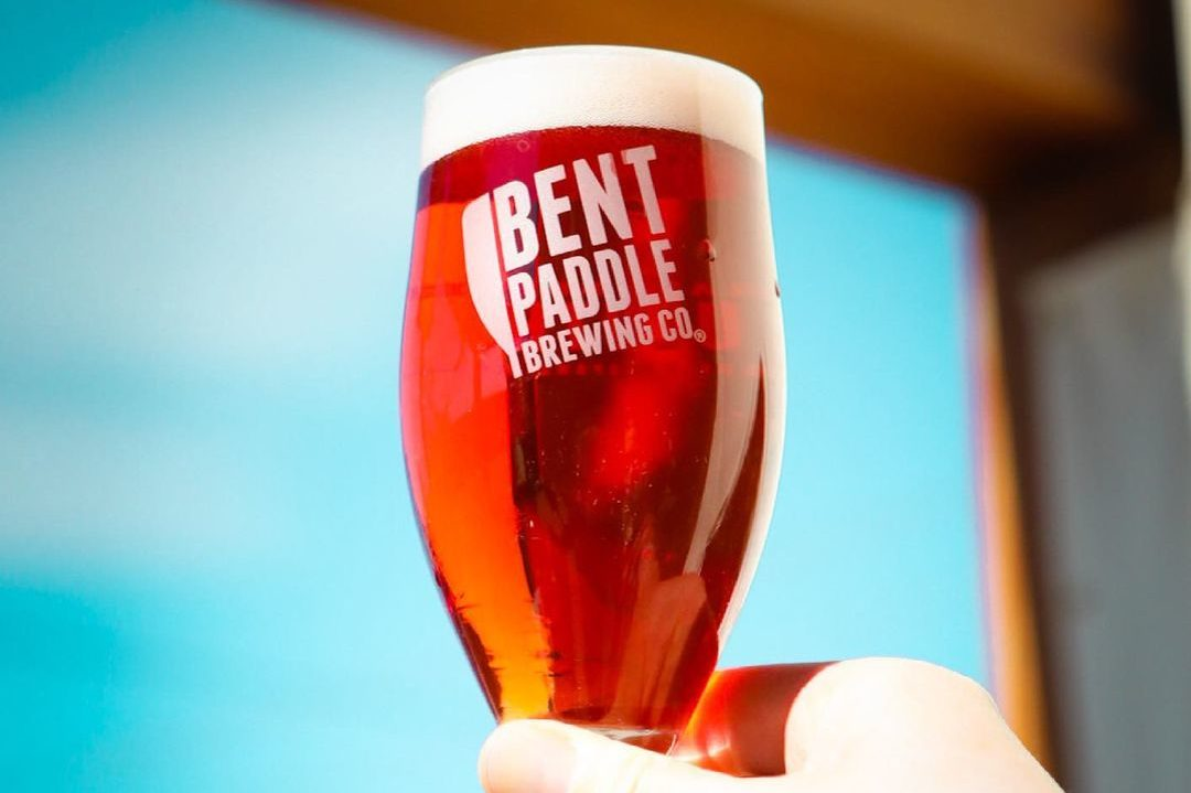Bent Paddle Out of the Oak Honeyberry Saison • Photo via Bent Paddle Brewing Company