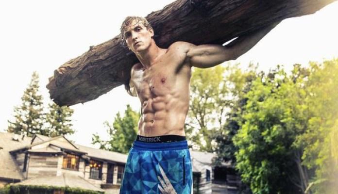 Logan Paul carries a big log
