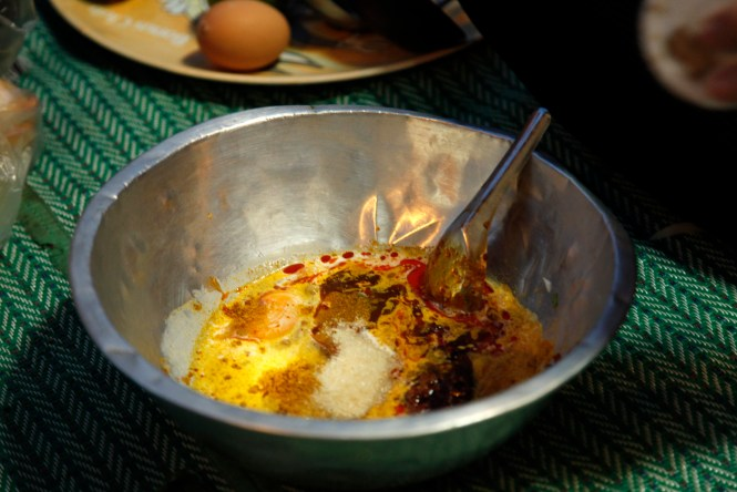 Mixing the curry powder paste. Photo Courtesy of Naurarat Suksomstarn.