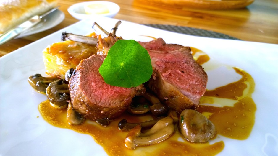 Pan fried rack of lamb, Mushroom Fricassee with parma ham, light lamb jus with Thyme