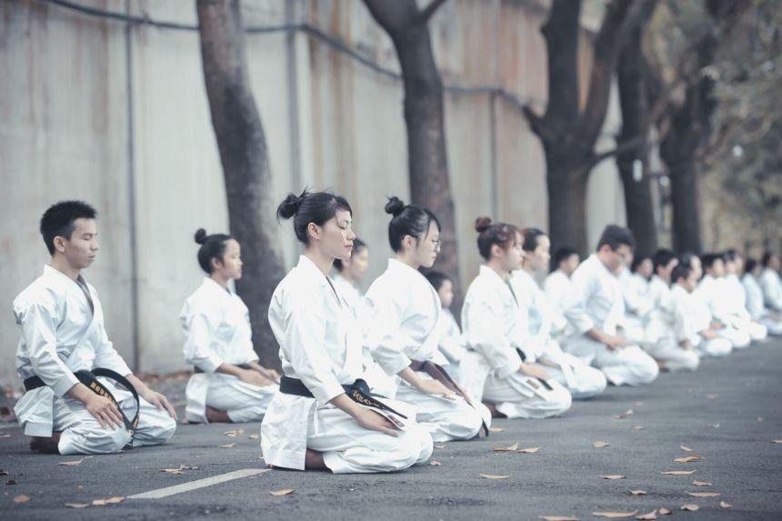 martial artists practicing their discipline through meditation