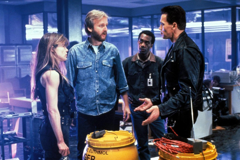James Cameron discusses a scene with actors Arnold Schwarzenegger
