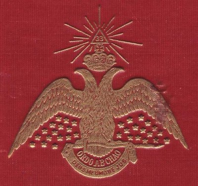 "The double-headed Phoenix sits atop the motto ""Ordo Ab Chao."""