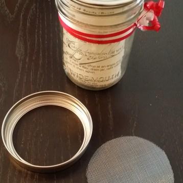 Put screen in metal ring, add storage lid, then screw onto jar.