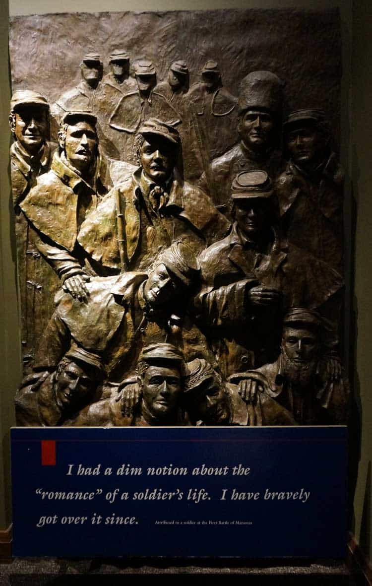 """3-D image of civil war soldiers with the text """"I had a dim notion about the 'romance' of a soldier's life. I have bravely go over it since."""""""