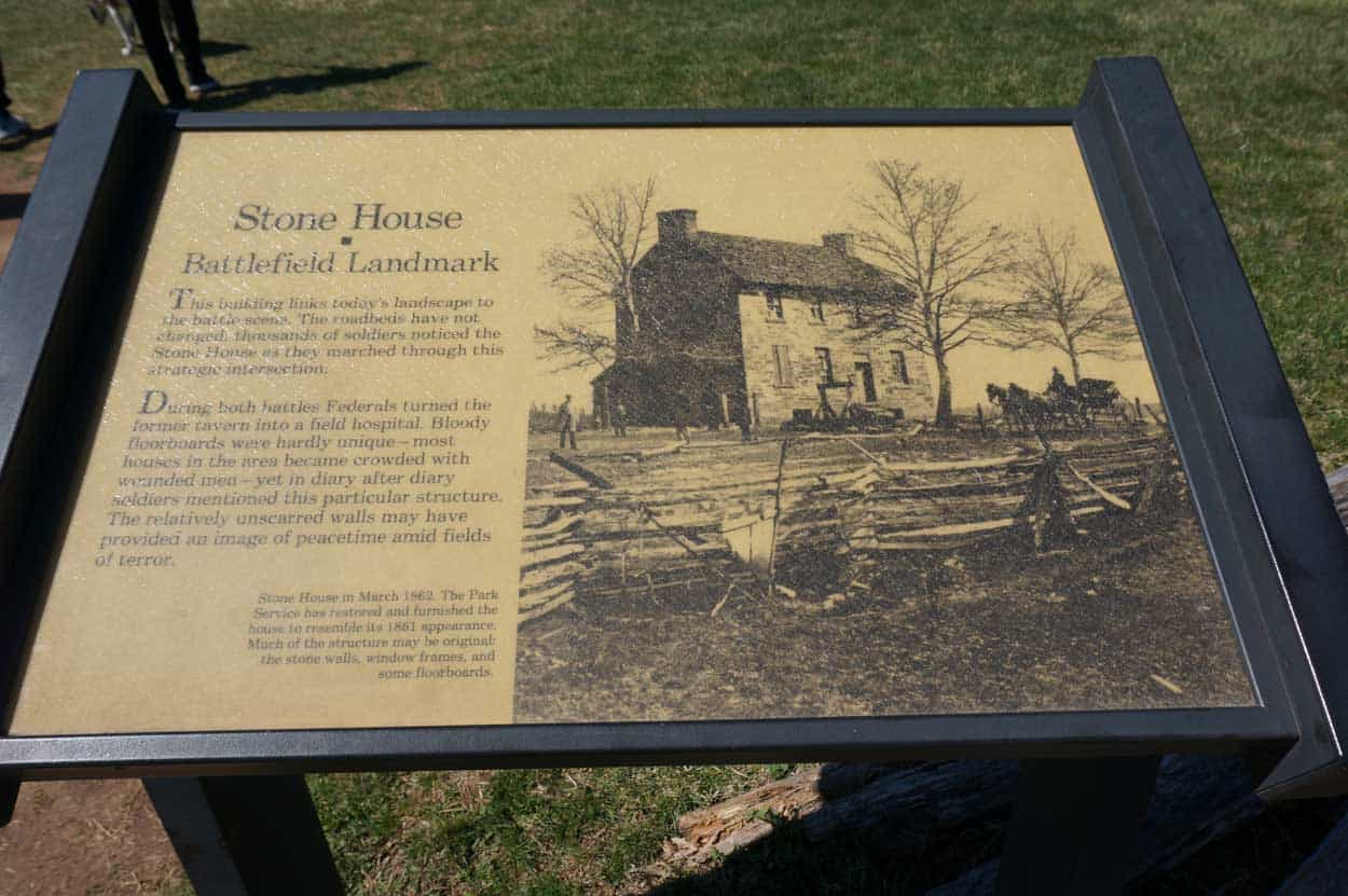Stone House field hospital interpretive sign with picture of house during the war