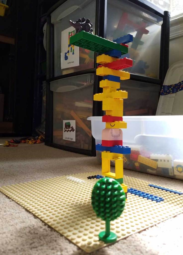 dinosaur toy on lego diving board