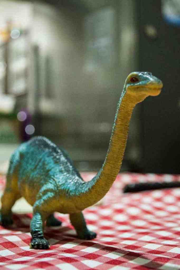 dinosaur toy on table