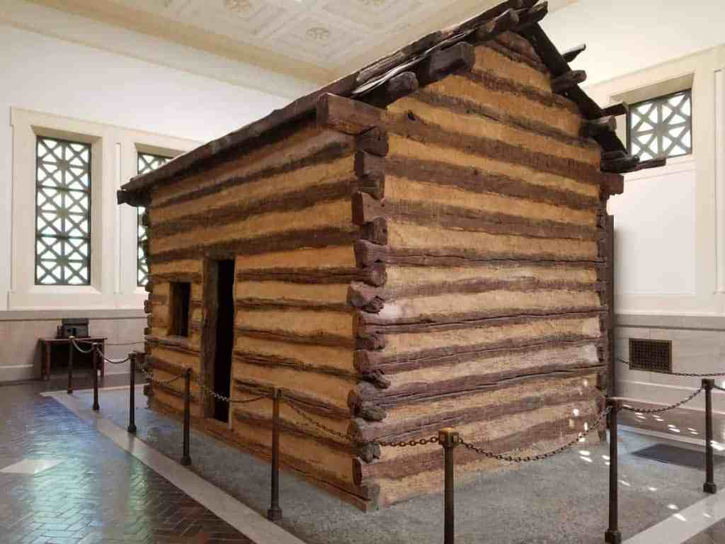 A replica of the cabin where Abraham Lincoln was born is housed inside the memorial building at Lincoln Birthplace National Historic Park