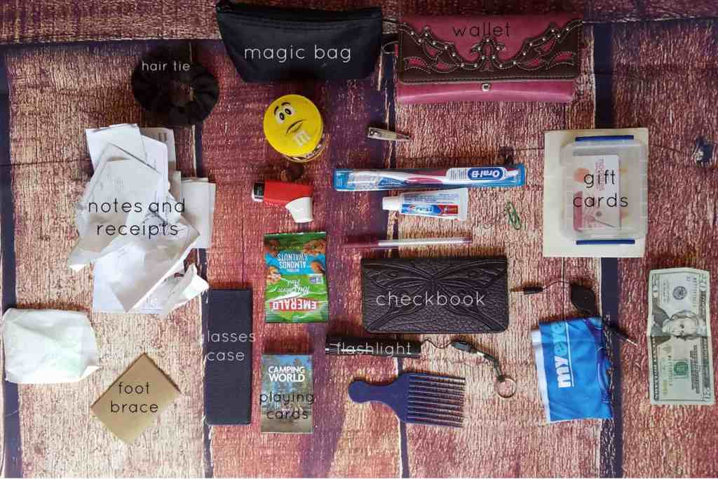 20 Days of Me - Day 5 - What's in your purse? The main compartment holds my wallet, magic black bag, and an assortment of other odds and ends.