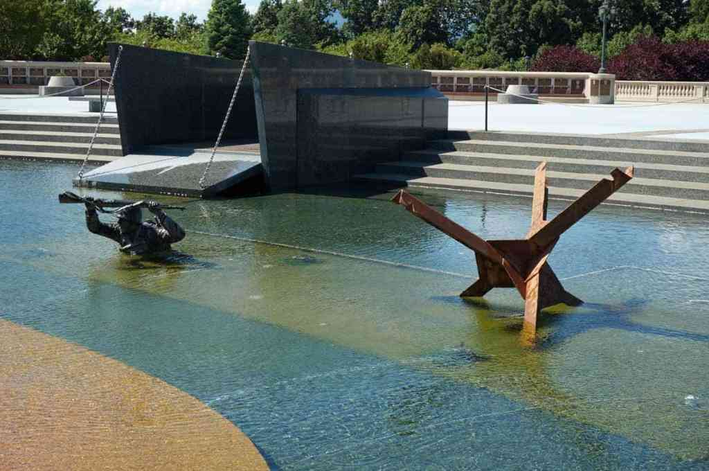 In the reflecting pool at the National D-Day Memorial, you can see a replica of an iron hedgehog, just one of the many obstacles faced by the men attempting to land at Normandy.