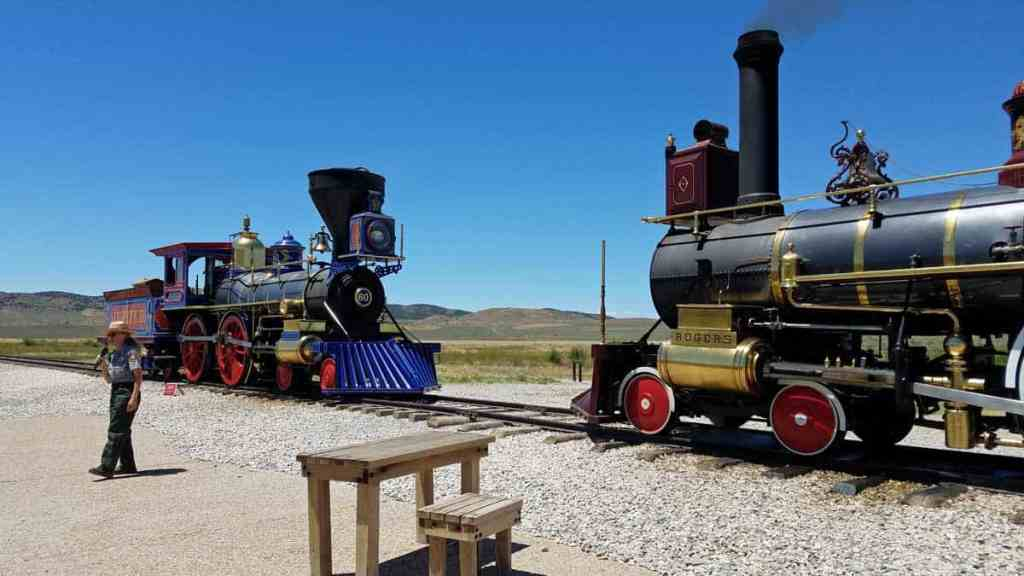 two trains meeting on the site of the historic golden spike of the transcontinental railroad
