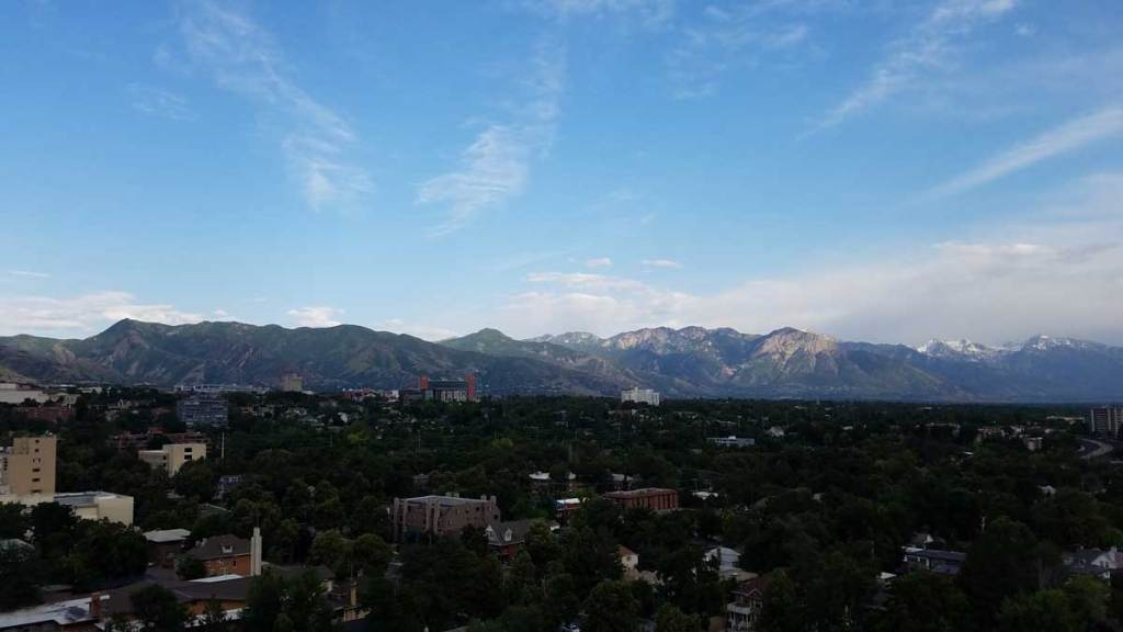 A view of the mountains east of Salt Lake City with the University of Utah at their base and some of the city visible in the foreground.