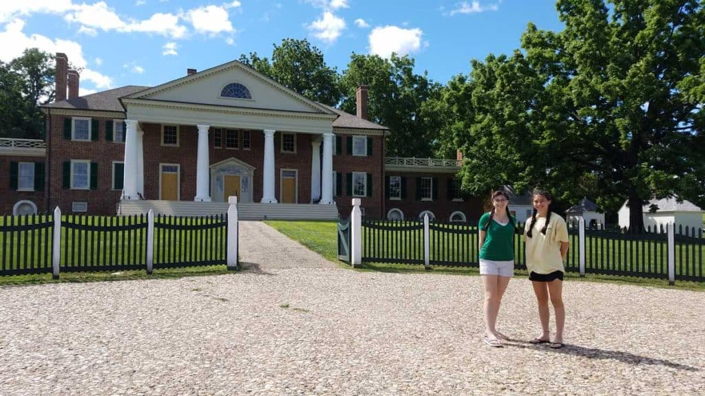 Standing outside the front gate of Montpelier, home of President James Madison