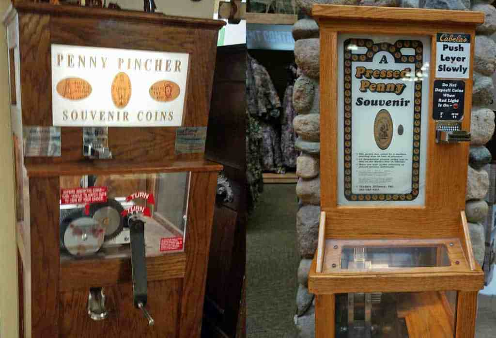 two penny machines - a hand-crank version and an electric version - both make elongated coins