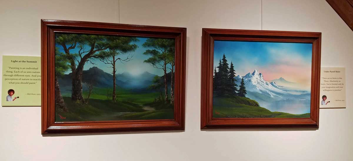 Two paintings by Bob Ross - Light at the Summit and Under Pastel Skies