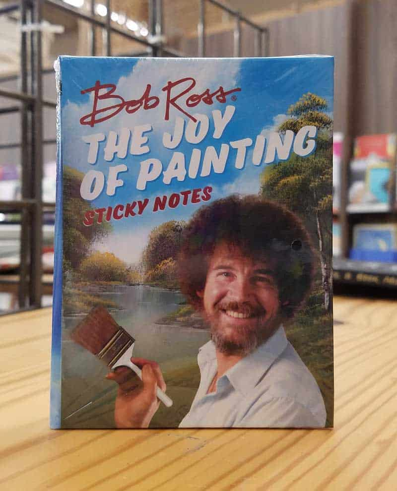 A package of Bob Ross branded sticky notes on display at a store