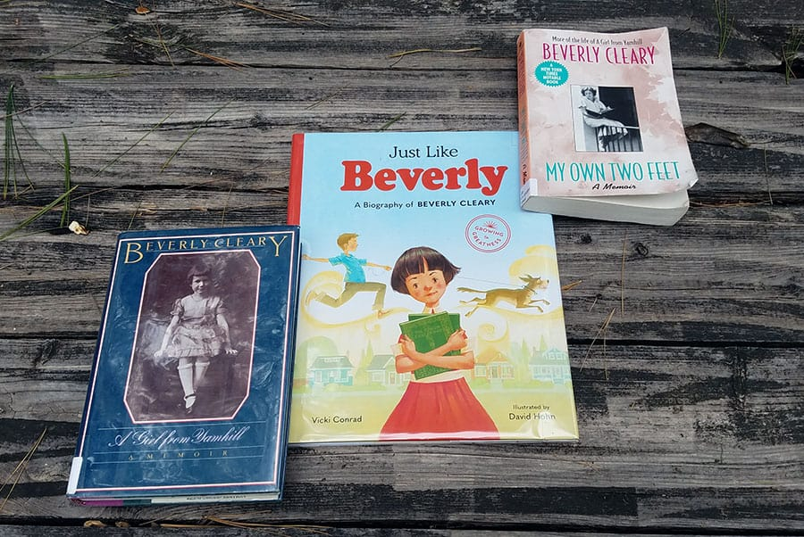 Three books laid on tabletop - A Girls from Yamill and My Own Two Feet by Beverly Cleary and Just Like Beverly by Vicki Conrad