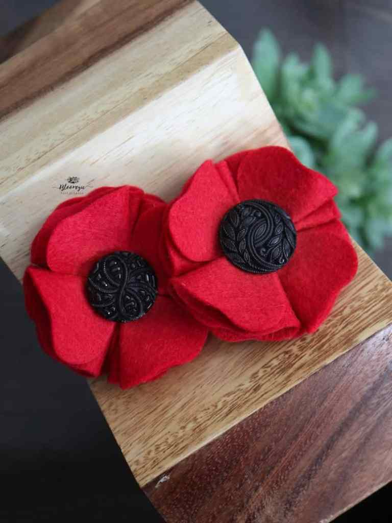poppy pin made from felt and buttons made by Maggie Lopes
