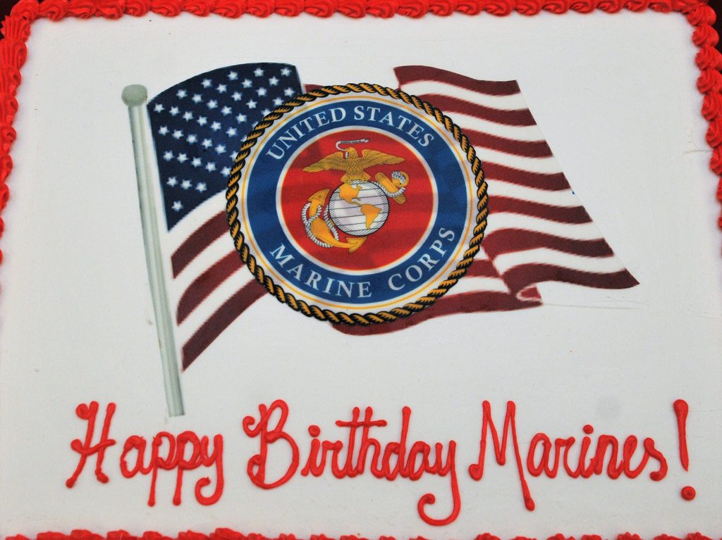 Orange Pd Hosts Marine Corps Birthday Party With Traditional Cutting Of Cake With Sword Behind The Badge