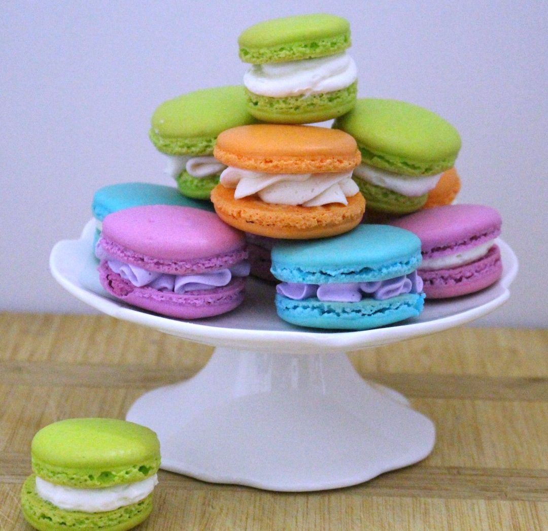 Behind the cake - colorful french macarons filled with buttercream.