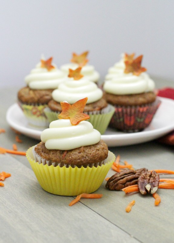 Behind the cake - Carrot cake cupcakes frosted with cream cheese and decorated with a fondant fall leaf