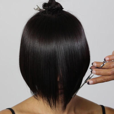 Slice into the fringe at the natural fall in order to connect the previous lengths while creating the desired outline and weight removal.