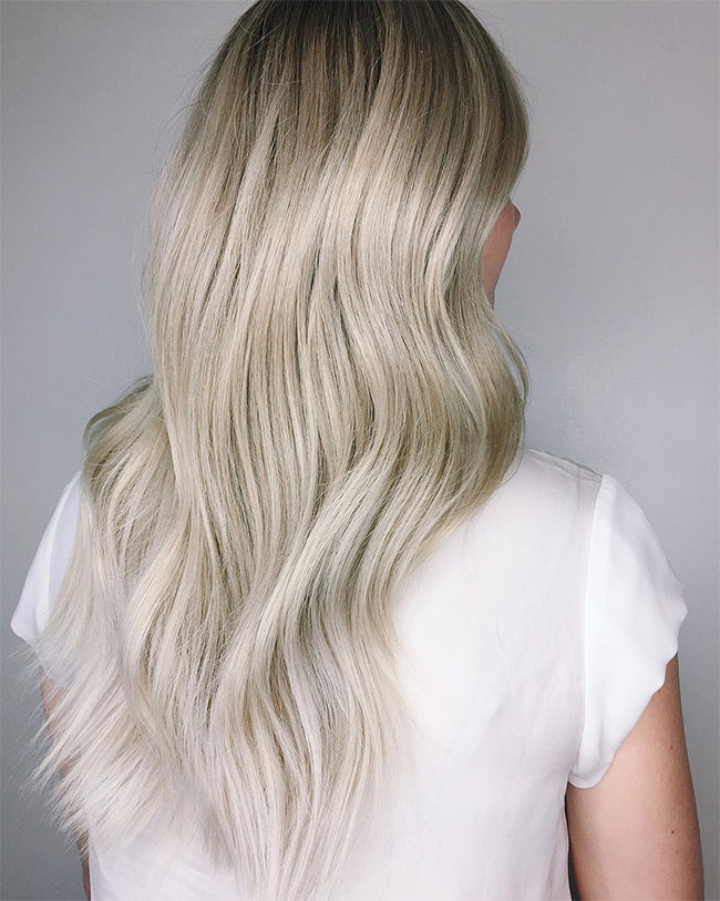 Vanilla blonde haircolor with darker shadow root by Chris Weber Hair