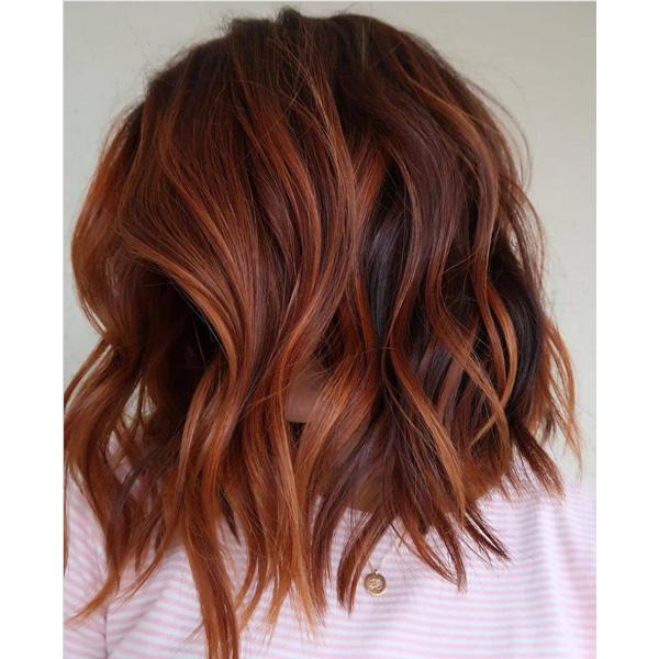 fall 2021 hair color trends pumpkin spice hair