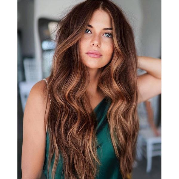fall 2021 hair color trends pumpkin ginger natural highlights
