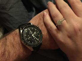 Taken around 2am right after the proposal. My engagement ring and his engagement watch.