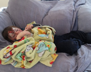 Nephew L napping on the couch