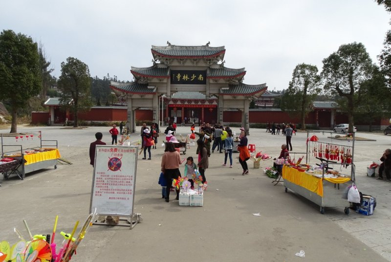 Souvenir stalls in front of archway that marks the entrance to the temple