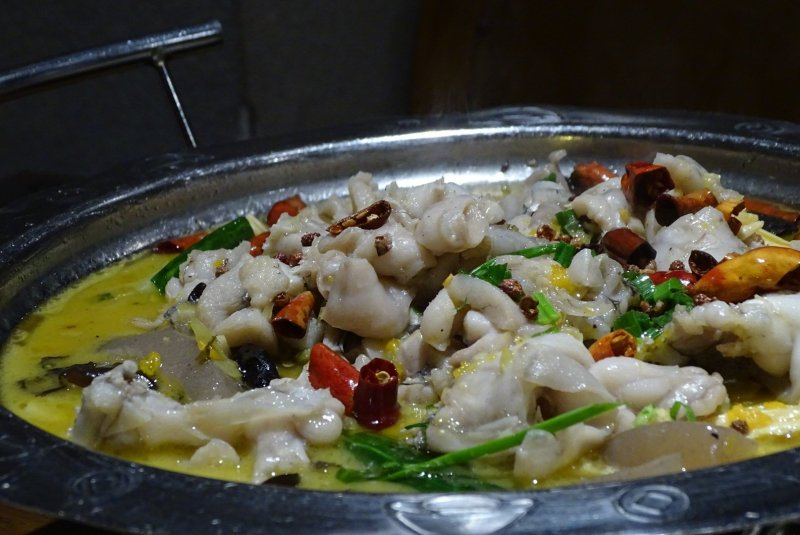 Frog stew in a metal pot