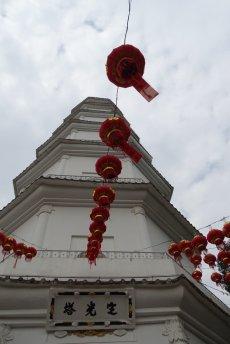 Photo of the White Pagoda, Fuzhou towering towards a cloudy sky