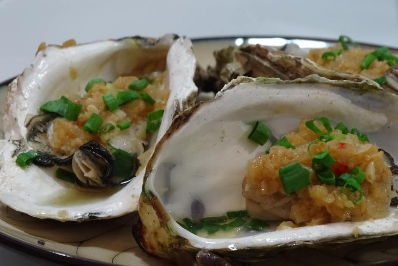 Barbecued oysters with garlic, chilli, and spring onions