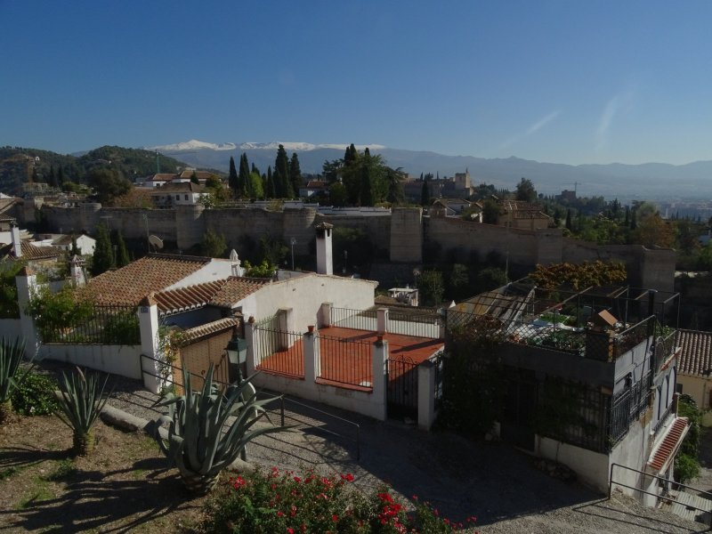 A splendid view from Mirador San Cristobal showing the fortifications and the Albaicín quarter. The Alhambra can be seen in the distance.