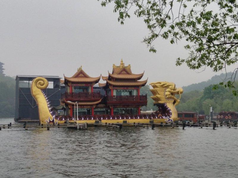 A boat shaped like a dragon on the lake