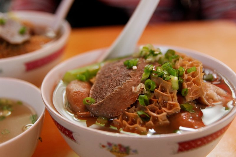 Tripe soup with beef, noodles, spring onions and a red sauce