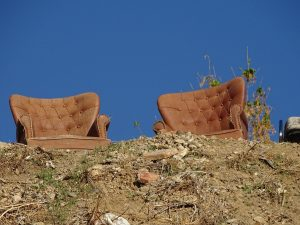 Two armchairs on top of the terrace of the hill