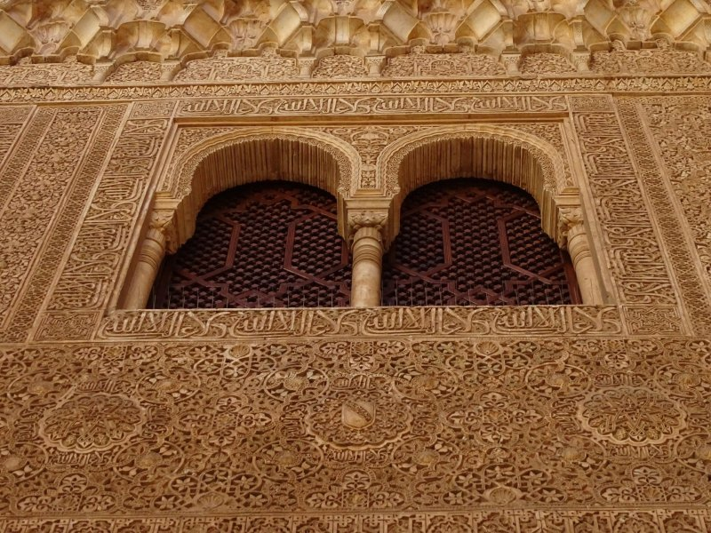 A picture of one of the ornate and intricate stuccoes inside the Alhambra