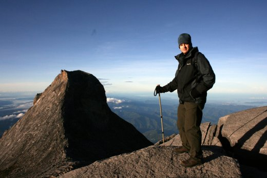 Me on Mount Kinabalu Summit, Sabah in Hiking Gear and Beanie