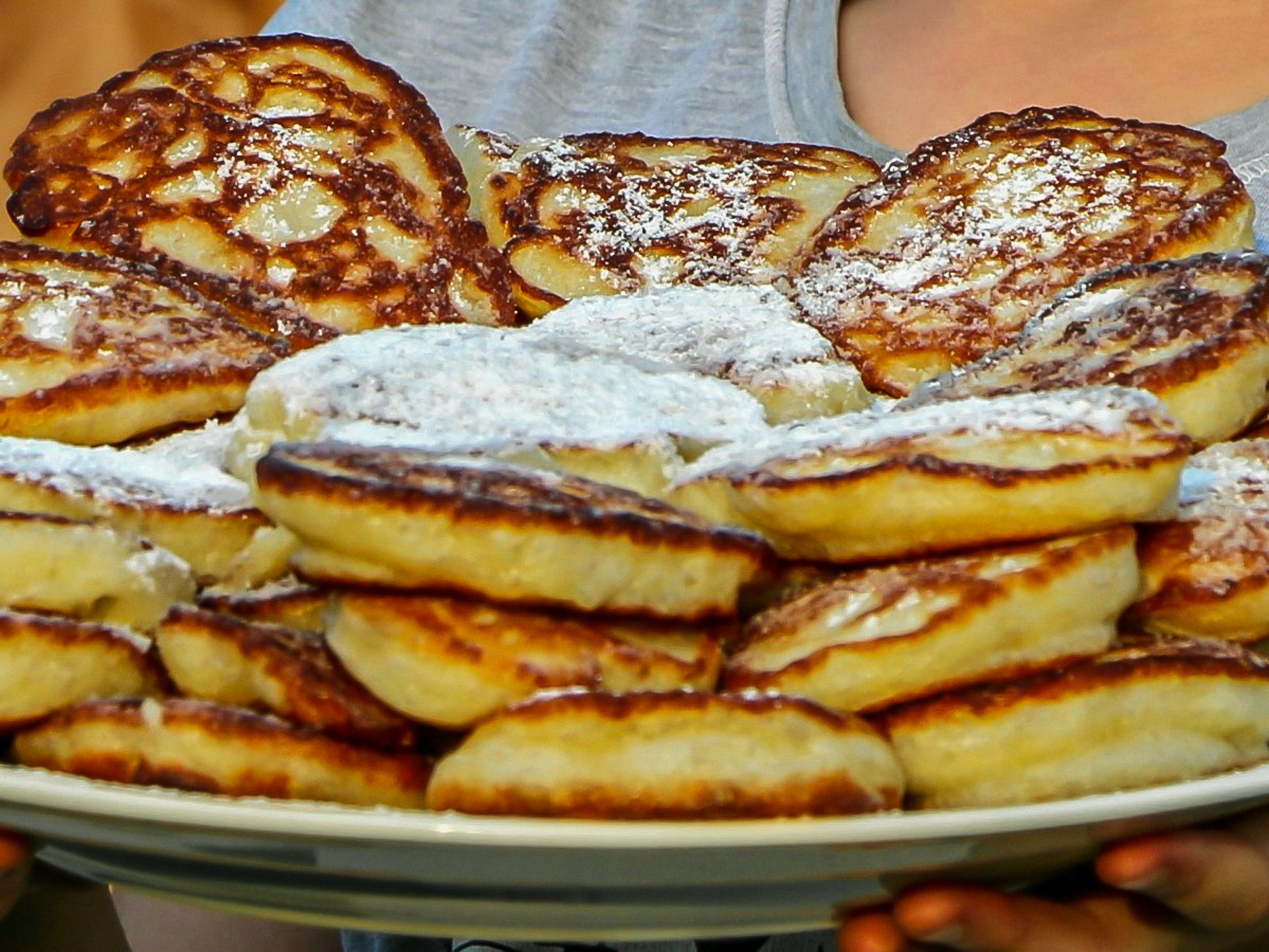 A plate of apple pancakes with sugar