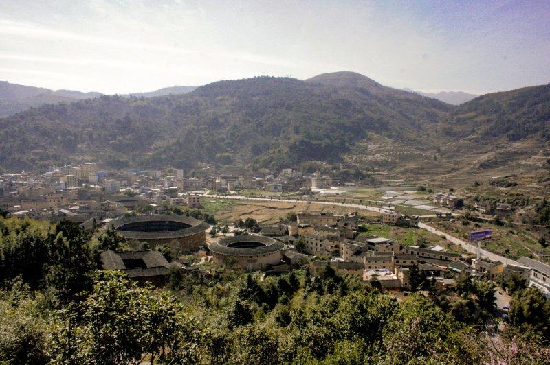 Aerial view of Gaobei village, hills in background.