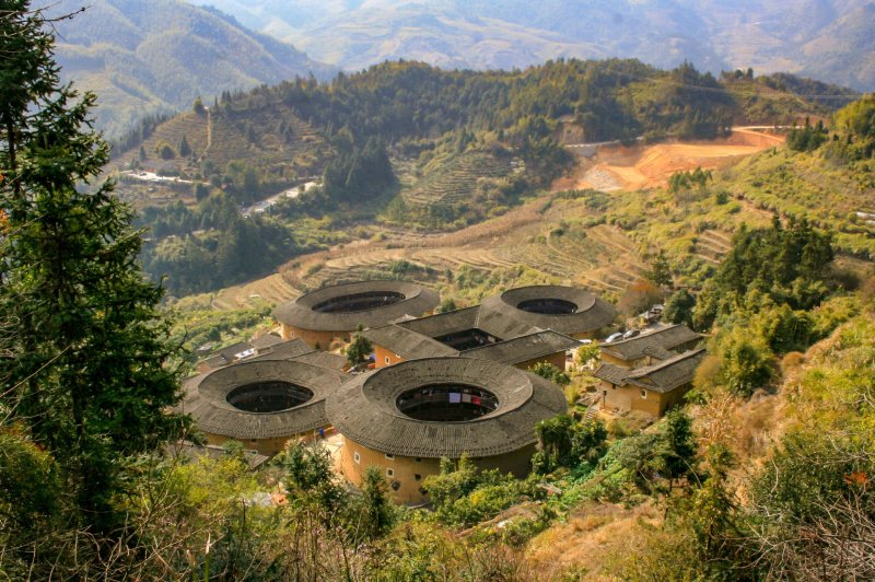 View of Tianluokeng from the viewing platform, showing four circular tulou around a central square one.